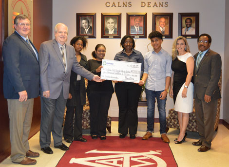 Alabama Farm Credit (AFC) representatives present $5,000 in scholarship funds to Alabama A&M University (AAMU)