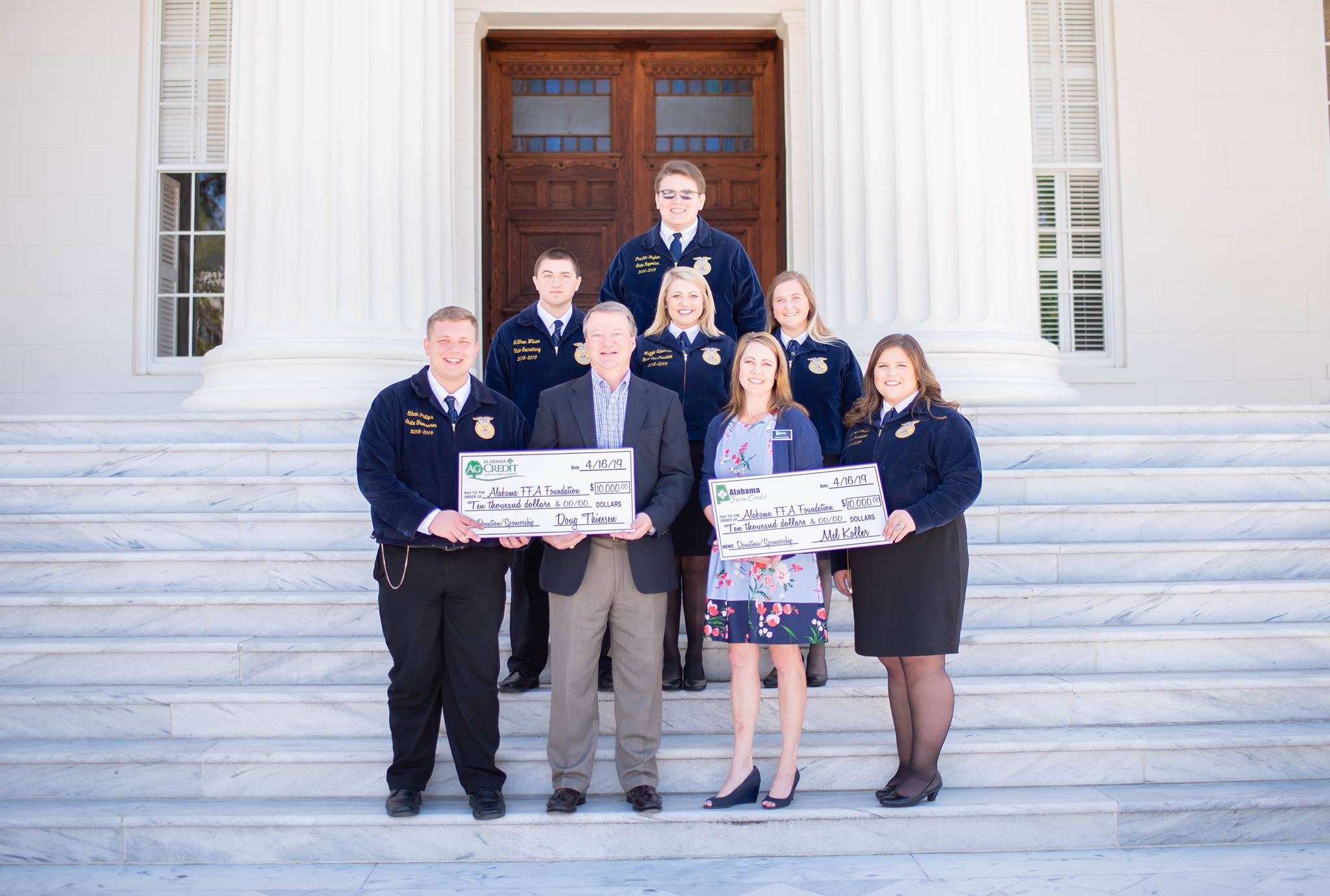 Pictured: Alabama Ag Credit's Doug Thiessen and Alabama Farm Credit's Brandi Jones with Alabama FFA State officers accepting the title sponsor donation